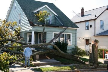 Storm damage to roof in Dickinson by Trinity Roofing & Builders